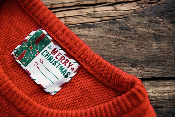 Christmas sweater with clothing label