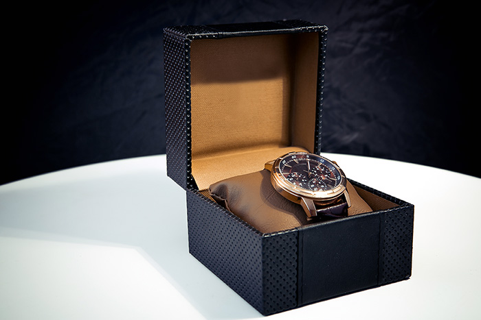Luxury mens wristwatch displayed and packaged in a box as a gift for a celebration
